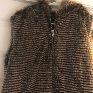 Faux fur hooded vest.